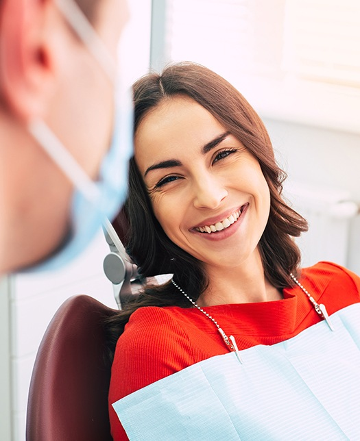 Woman visiting dentist for checkup to prevent dental emergencies