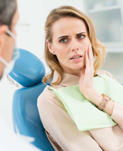 Woman talking to dentist about the cost of treating dental emergencies