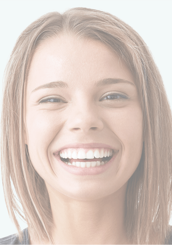 Woman smiling after receiving safe dental care