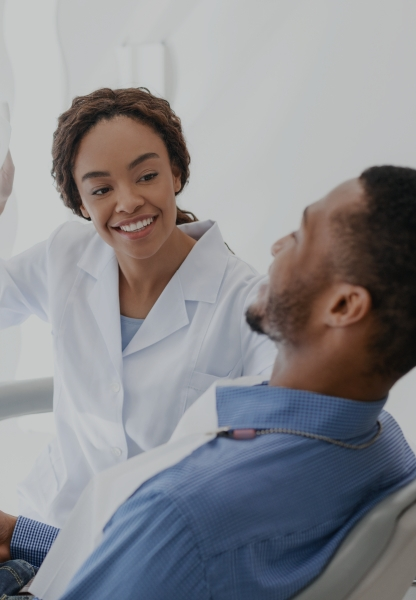 Man smiling during cosmetic dentistry consultation