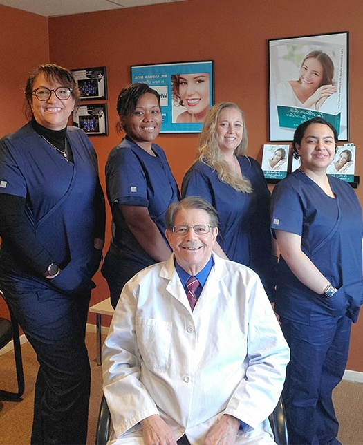 Doctor Dine and his dental team