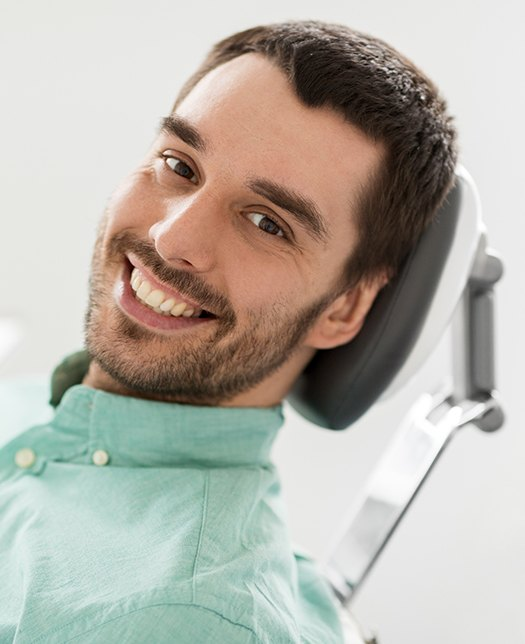 Man smiling after dental visit
